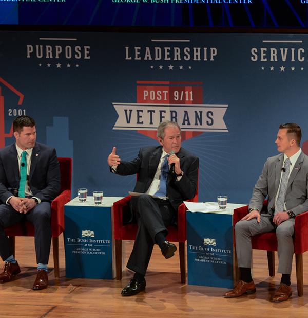USMC Veteran Brian Stann and USMC Veteran Dave Smith alongside President George W. Bush.  (Grant Miller / George W. Bush Presidential Center)