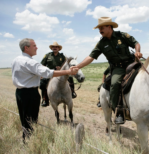 President George W. Bush meets with mounted U.S. Border Patrol agents along the U.S.-Mexico border Thursday, Aug. 3, 2006, in the Rio Grande Valley border patrol sector in Mission, Texas. (Eric Draper / George W. Bush Presidential Library and Museum/NARA)