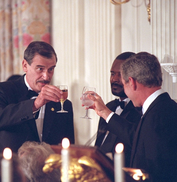 Presidents Fox and Bush toast each other at the State Dinner Wednesday evening at the White House. (Eric Draper / George W. Bush Library and Museum/NARA)