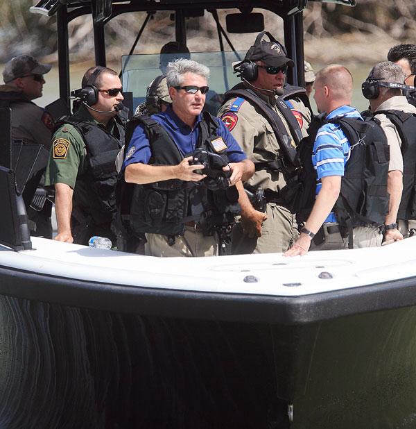 U.S. Rep. Michael McCaul (center) at the Anzalduas County Park along the Texas/Mexico border, Mar. 6, 2013. (AP/The Monitor, Gabe Hernandez)