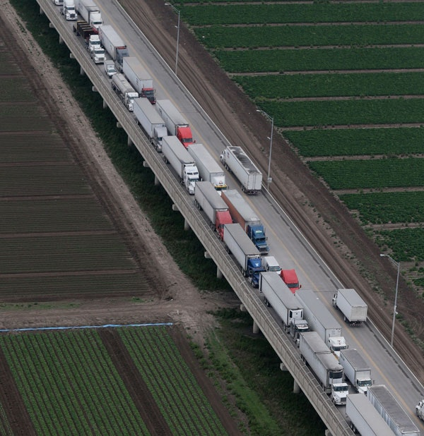 Trucks wait in line on the Pharr International Bridge near the Texas-Mexico border, Feb. 24, 2015. (AP Photo/Eric Gay)