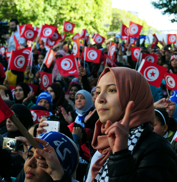 Tunisians celebrate the fifth anniversary of the Arab Spring, Thursday, January 14, 2016 in Tunis. (AP Photo/Riadh Dridi)