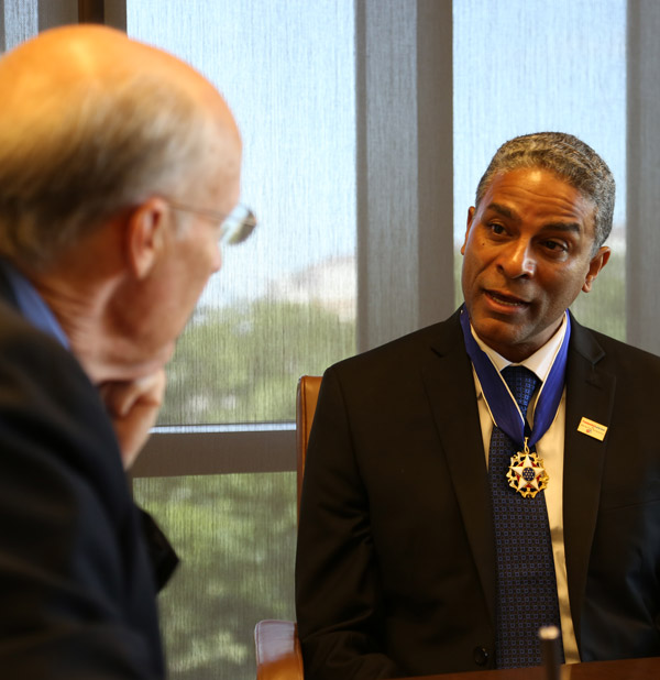 Dr. Oscar Biscet wears his Presidential Medal of Freedom as William McKenzie interviews him at the Bush Center, June 23, 2016. (Andrew Kaufmann / George W. Bush Presidential Center)