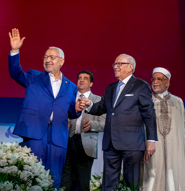 President of Ennahda movement Rached Ghannouchi, Tunisian President Beji Caid Essebsi and Tunisian Assembly of the Representatives of the People Vice President Abdelfattah Mourou at the 10th General Assembly of Ennahda Party in Rades, Tunisia on May 20, 2016. (Nicolas Fauque/Images de Tunisie/Sipa USA