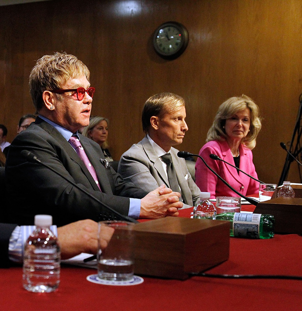 Sir Elton John, Dr. Mark Dybul, and Ambassador Deborah L. Birx, M.D. testify before a U.S. Senate subcommittee hearing on global health programs, May 6, 2015 in Washington, D.C. (Paul Morigi/Getty Images