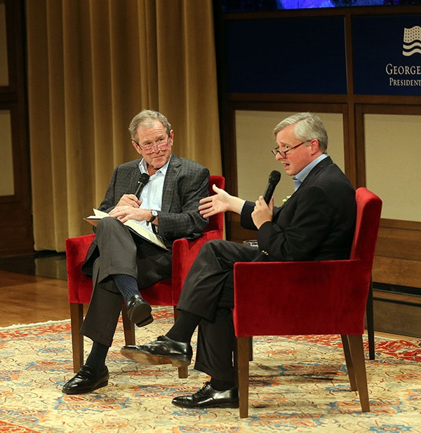 Jon Meacham discusses George H.W. Bush with President George W. Bush (Grant Miller / George W. Bush Presidential Center)