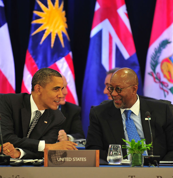 President Barack Obama speaks to U.S. Trade Representative Ron Kirk during a meeting with Trans-Pacific Partnership leaders in Honolulu, Hawaii, on November 12, 2011.