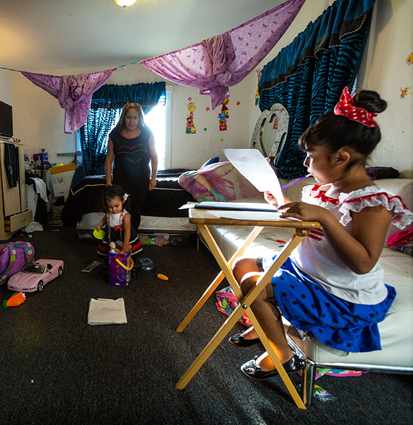 Melina Vasquez supervises homework time. 84% of Hispanic parents have a specific place set aside for homework. [NCES, Parent and Family Involvement in Education, from the National Household Education Surveys program of 2012]