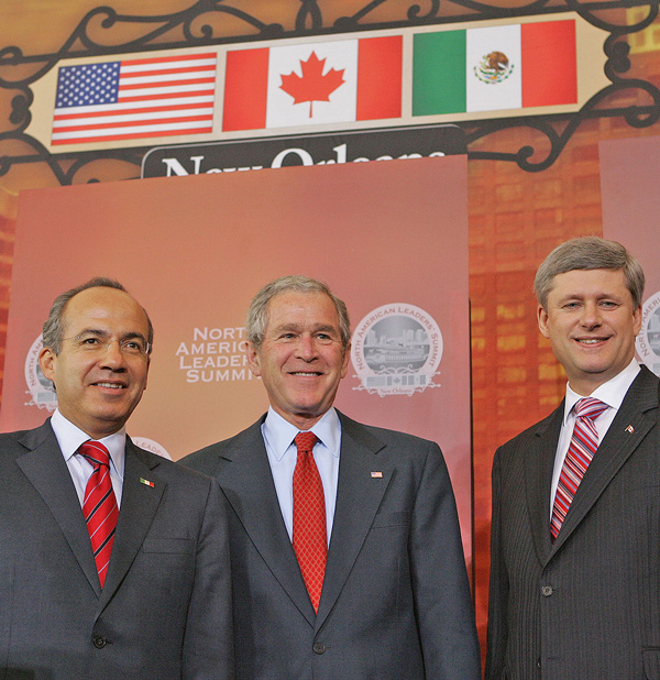 George W. Bush at Gallier Hall for the joint news conference with Mexico  President Felipe Calderón and Canadian Prime Minister Stephen Harper during  the ...
