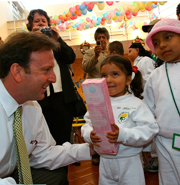 Ambassador Antonio Garza gives a Christmas gift to a child at the Casa de la Amistad home for children with cancer in Mexico City, Mexico on Dec. 15, 2005. (AP Photo/Marco Ugarte)