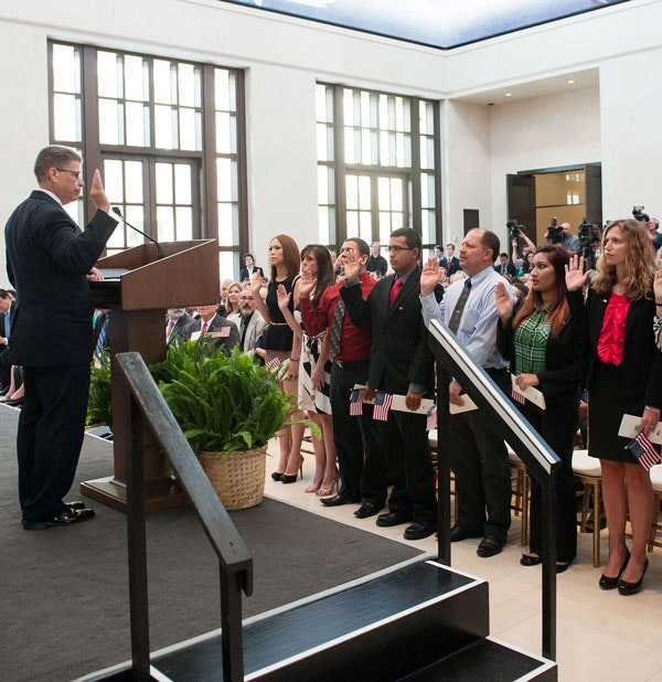 The Bush Insttitue hosted a naturalization ceremony honoring 20 new citizens from 12 countries, July 10, 2013. (Grant Miller / George W. Bush Presidential Center)
