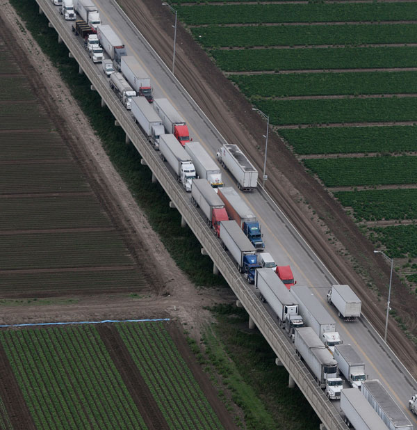 Trucks wait in line on the Pharr International Bridge near the Texas-Mexico border, Feb. 24, 2015.  (AP Photo/Eric Gay)