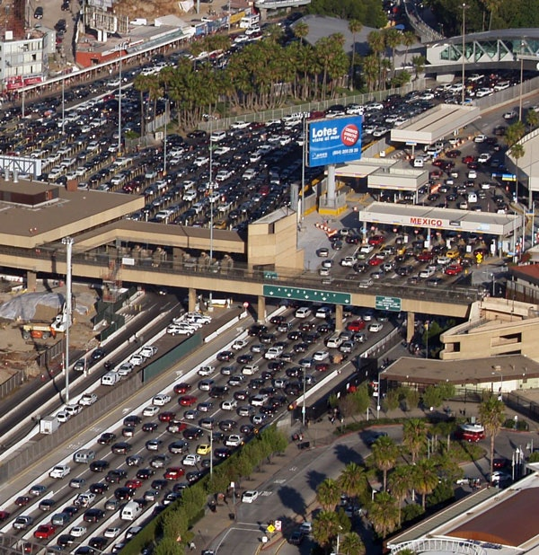 Aerial view of the U.S. San Ysidro Port of Entry (left), and Méxican El Chaparral Point of Entry (right). The border crossing between San Diego, California and Tijuana, Baja California state. (Phil Konstantin)