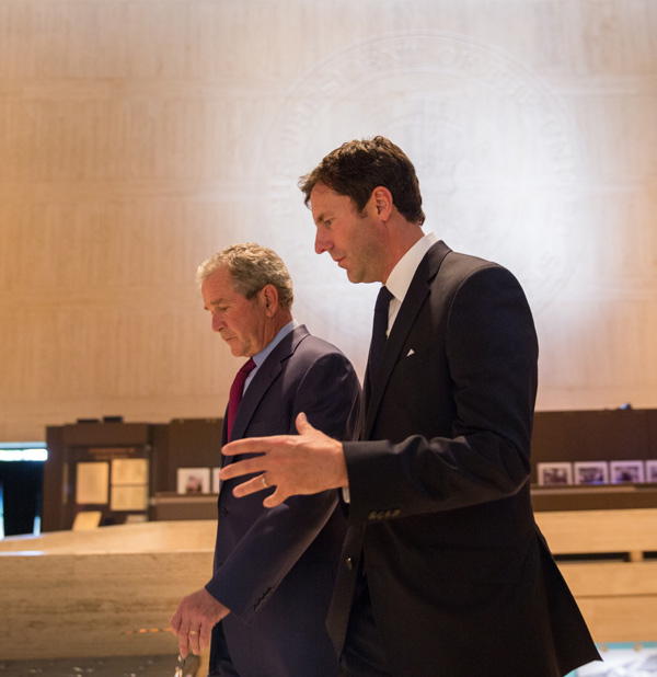 President George W. Bush arrives at the LBJ Presidential Library with Mark Updegrove for the Civil Rights Summit. (Eric Draper/LBJ Presidential Library)