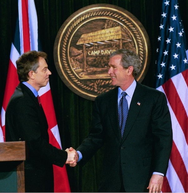 President George W. Bush and British Prime Minister Tony Blair shake hands after they conclude a joint news conference at the Camp David, March 27, 2003. (Paul Morse/White House)