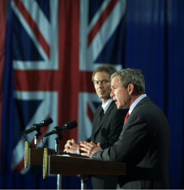 President George W. Bush appears with British Prime Minister Tony Blair at a press conference at Crawford High School in Crawford, Texas on April 6, 2002. (Paul Morse/White House)