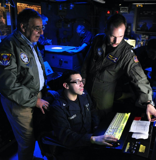 Secretary of Defense Leon Panetta is briefed on the functions of the combat direction center during a visit aboard the aircraft carrier USS Enterprise (CVN 65). Atlantic Ocean Jan. 21, 2012 (Mass Communication Specialist 2nd Class Michael L. Croft Jr.)