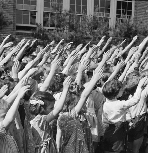 As part of the Pledge of Allegiance, students in 1942 perform the Bellamy Salute.  Religious freedom advocates felt that requiring the Pledge violated First Amendment rights. (Library of Congress)