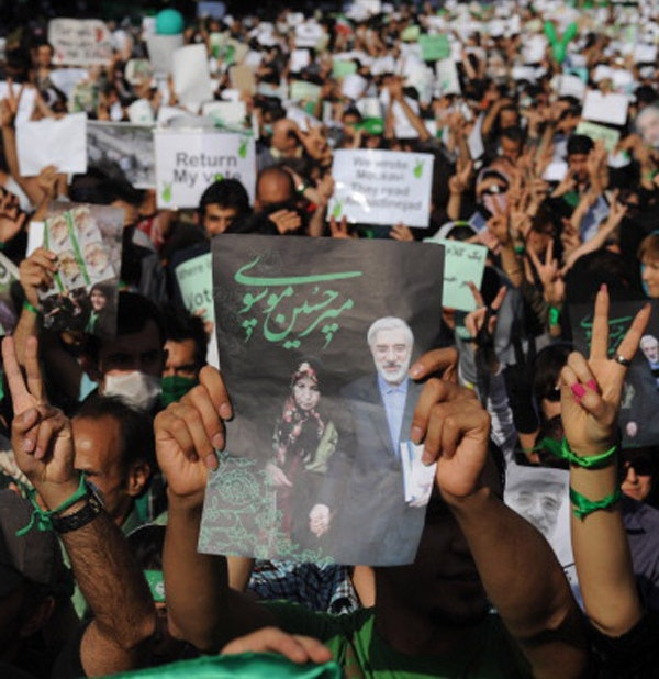 Demonstrators carry banners and pictures of Mir Hossein Mousavi, the defeated reformist candidate, during a march on Karimkhan Street, Tehran, June 17, 2009.  (Kaveh Kazemi/Getty Images)
