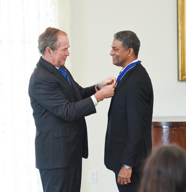 President Bush awards the Presidential Medal of Freedom to Dr. Oscar Biscet at the Bush Center on June 23, 2016.