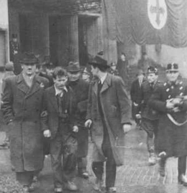 Members of the fascist Arrow Cross Party arrest Jews. Budapest, Hungary, October-December 1944.  (US Holocaust Memorial Museum)