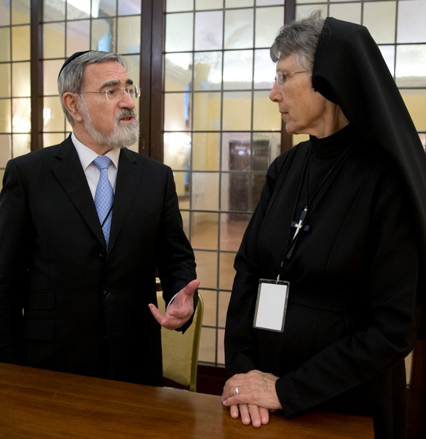 Rabbi Lord Jonathan Sacks, left, talks with Sister Prudence Allen during a press conference, at the Vatican, Monday, Nov. 17, 2014. (AP Photo/Andrew Medichini)