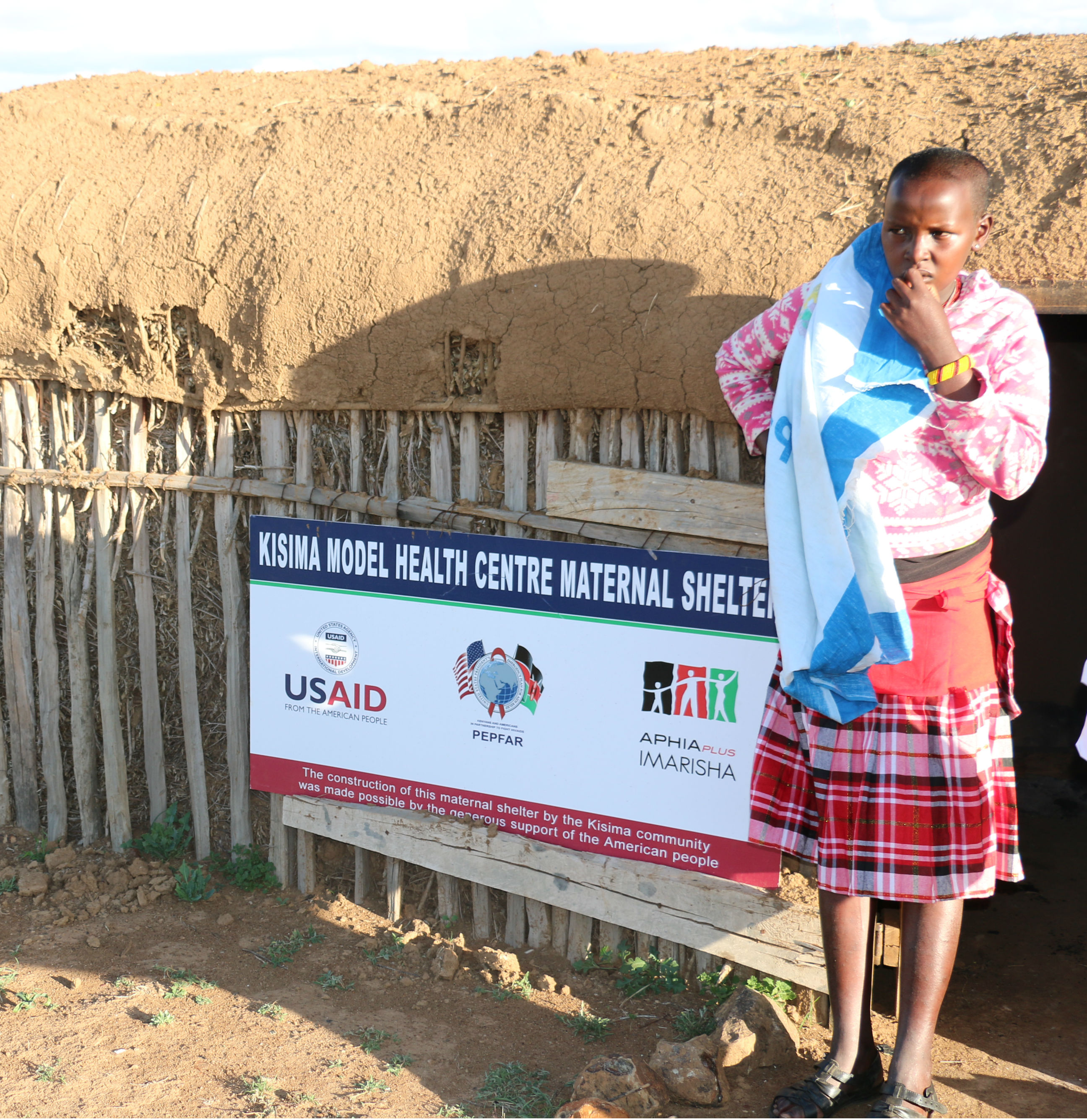 An expectant woman stays at the shelter as she awaits to deliver her child. (Eric Onyiego/ USAID Kenya)