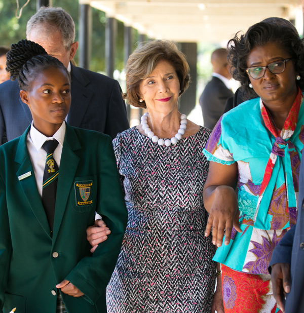 Mrs. Bush and First Lady Monica Geingos of Namibia walk with a student at Ella Du Plessis High School in Windhoek, Namibia, April 2017. (Paul Morse / George W. Bush Presidential Center)
