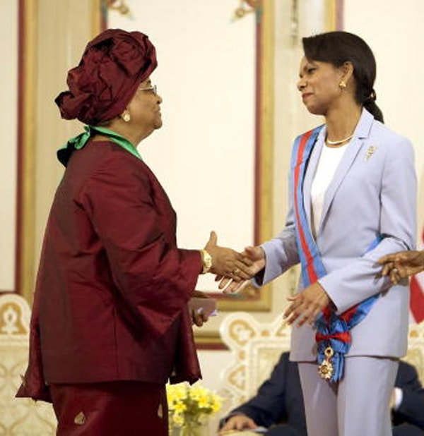 Liberian President Ellen Johnson Sirleaf and U.S. Secretary of State Condoleezza Rice (C) shake hands during a ceremony at the Executive Mansion in Monrovia, Liberia, on February 21, 2008. (Jim Watson/AFP/Getty Images)