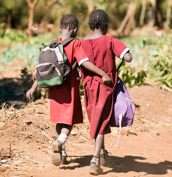 Girls walk with their book bags in Zambia in 2013. (Paul Morse / George W. Bush Presidential Center)