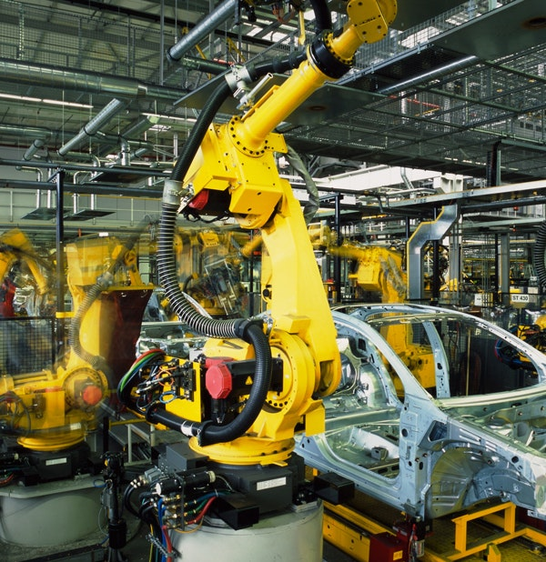 Robots working on cars on an assembly line